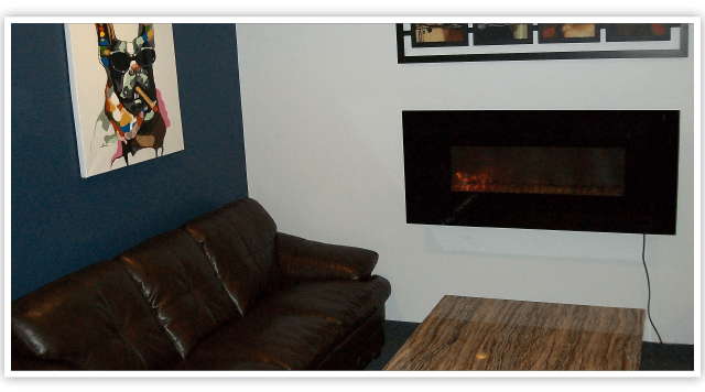 Couch by fireplace